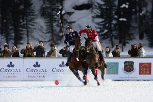 polo ponies and riders in action playing snow polo