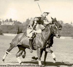 Walt Disney in action playing polo