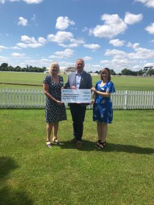 Major Richard Carney presenting the cheque to the The Shakespeare Hospice