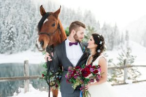 winter weddings - photo with horse and snow back drop